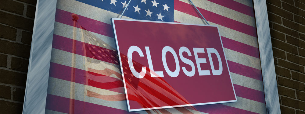 Government shutdown metaphor of closed sign on flag